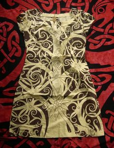 Kenyah Dayak (upriver Borneo tribe) tree of life patterned tan and yellow dress.