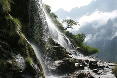 Waterfall, Tiger Leaping Gorge  Photograph by Alexander Steigerwald, My Shot    This is a waterfall on the edge of a cliff more than a vertical mile above the Yangtze River in the mountains of the Tiger Leaping Gorge outside of Lijiang City, Yunnan, in southwestern China.