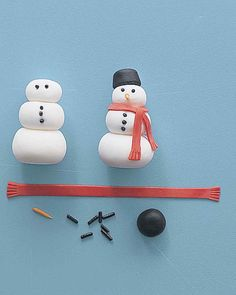 These merry snowmen get their roly-poly forms, red scarves, and carrot noses from rolled fondant, a thick, pliable sugar mixture often used to give wedding cakes a smooth finish (you'll find it at baking-supply stores). Chocolate sprinkles stand in for coal eyes and buttons; licorice drops make the hats.