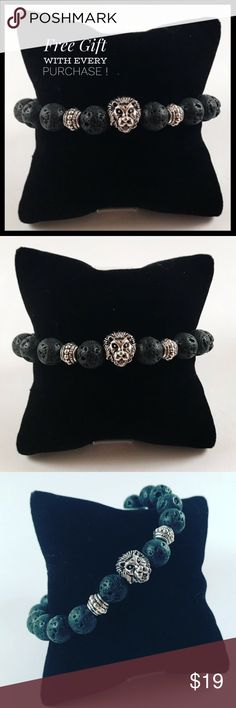 """Men beaded bracelet lion head charm lava rock FREE GIFT WITH EVERY PURCHASE !! LET ME KNOW IF YOU WANT MEN OR WOMEN GIFT WHEN PURCHASING Men beaded bracelet. Fits most , 7.5 to 8.5 inch wrist. Handmade by me , never worn by anyone. Made with 8mm lava rock ( volcano rock). Silver plated lion head . I ship fast!!✈️ Bundle and save! ( 10 % off bundles) . Any questions let me know! No transactions outside Poshmark!!  2 for $25!! All Items marked with the fox """""""" emoji are 2 for $25 ju"""