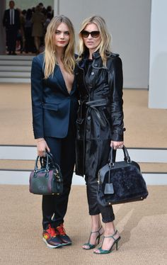 Cara Delevingne at London Fashion Week with Kate Moss. See all of the model's best looks.