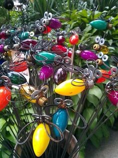 "Outdoor/Garden Decor IDEA | ""Lightening Bugs"" made from old Christmas lights, washers & wire."