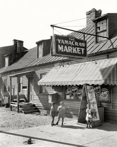 """Savannah, Georgia, circa 1939. """"Yamacraw Market, Fahm Street. Rowhouse structure built about 1850. Torn down 1940 for Yamacraw Village Housing Projects."""" 8x10 acetate negative by Frances Benjamin Johnston"""