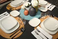 Beau Ovale Dinnerware By Alessi Paired With David Melloru0027s Pride Flatware Served  On A Mini Basketweave Oval