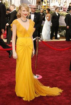 Pin for Later: 85 Unforgettable Looks From the Oscars Red Carpet Michelle Williams at the 2006 Academy Awards Thanks to Vera Wang, canary yellow has never looked as amazing as it did on Michelle Williams in 2006.