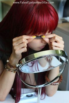 Instead of a hand mirror, use a swivel mirror and place it just beneath your face. Adjust the angle and prop your elbows up on the table for support.  The key thing is to always place your mirror somewhere beneath your face.