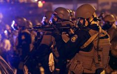 PHOTOS: The Shocking Images From Yet Another Night Of Clashes In Ferguson