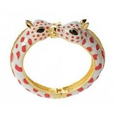 Enameled giraffe bangle with magnetic closure.  We think our enameled Animal Bangles are wildly wonderful! Designed with two colorful giraffes; available in pink, orange, translucent orange, green or black. Bangle includes small magnets on the ends to ensure proper closure.  Magnetic closure