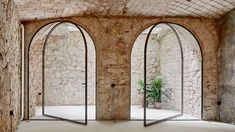 Metric turns bomb-blasted banana warehouse in Barcelona into triplex apartment - Architecture Entrance Design, House Entrance, Entrance Doors, Door Design, House Design, Arched Doors, Pivot Doors, Windows And Doors, Indoor Courtyard