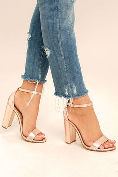 The Steve Madden Carrson Rose Gold Leather Ankle Strap Heels are on fire with a simple design that is a total knockout! Metallic genuine leather shapes a minimal toe strap and adjustable ankle strap (with rose gold buckle).