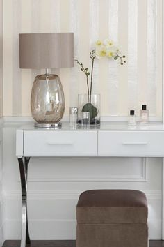 Stripes of gloss and matte paint in light neutrals can create a very sophisticated feel