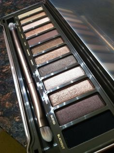 Urban Decay Naked 2. Much more neutral toned (though still warmish) and a bit less glitter than the original.      $50 geekgoddess