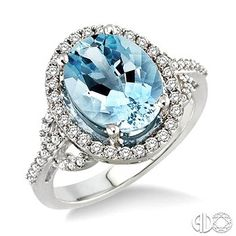 11x9mm Oval Cut Aquamarine and 3/8 Ctw Round Cut Diamond Ring in 14K White Gold