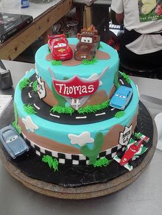 Cars theme cake with toy cars as toppers. I like the roads for the toy cars in between layers.