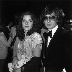 Amy Irving and Steven Spielberg.  When they divorced, she received 100 million dollars- the third most expensive divorce on record at that time.