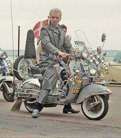 Sting on a Vespa scooter from the film Quadrophenia. Scooter Garage, Mod Scooter, Scooter Motorcycle, Scooter Girl, Scooters Vespa, Lambretta Scooter, Motor Scooters, Vespa Bike, Vespa 150