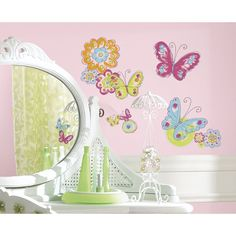 Decorate your kid's bedroom with removable butterfly wall decals. These sweet little butterflies and flowers have a charming hand-painted look