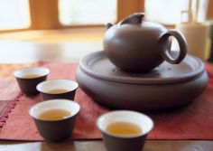 This is a great website for learning more about the Gong Fu method of tea preparation.  A Gong Fu pot made of Yixing clay with slowly take on the flavor of the tea and enhance the experince.  You need to try this if you're a tea drinker!