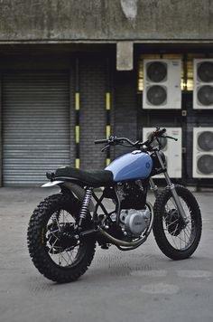 Yamaha SR250 by Auto Fabrica.  That blue is the best.  What an understated beauty.