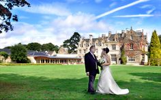 Bride & Groom on the lawn at Shendish Manor in Hertfordshire. gdh-weddingphotographer.co.uk