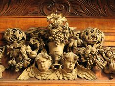Wood carving of Eucharistic symbols in Trinity College chapel in Oxford by Grinling Gibbons.