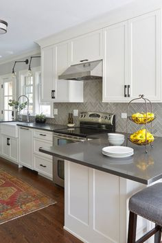 Functional And Family Focused Transitional Kitchen With White Cabinets And Gray Herringbone Backsplash Tiles Backsplash Kitchen White Cabinets, Grey Countertops, Kitchen Cabinet Design, Kitchen Redo, Home Decor Kitchen, Interior Design Kitchen, New Kitchen, Home Kitchens, Backsplash Ideas