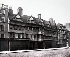 Staple Inn was originally attached to Gray's Inn, one of the four Inns of Court. The original building dates from 1585, but after heavy damage from a German bomb in 1944, it was extensively restored - making it a far more splendid front today than that seen by the 19th-century shoppers of Holborn. Photo: Henry Dixon, 1870s.
