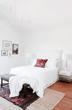 Bright and airy bedroom with a gold chandelier, layered rugs, and matching table lamps - Home Decor - Style & Trends - Home Decor - Style & Trends Airy Bedroom, White Bedroom, Modern Bedroom, Master Bedroom, Bedroom Decor, Bedroom Ideas, Bedroom Inspo, Bedroom Rugs, Bedroom Setup