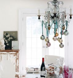 Hang ornaments from chandelier