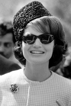 1962 - During her visit to the Khyber Pass region of the Pakistan, Jackie wears a traditional Pakistani hat - called a Jinnah cap - of astrakhan fur, that was given to her personally by President Ayub Khan.