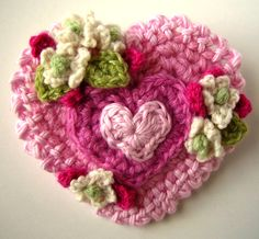 Crochet Valentine Heart Pin. Made from recycled yarns all cashmere except the lightest pink which is a baby soft cotton. Measures 3 inches across, felt on the back with a 1 1/2 inch bar pinback.