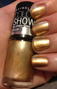 Just bought Maybelline Color Show Nail Lacquer in Bold Gold to paint my nails for my high school football games :) Really like it