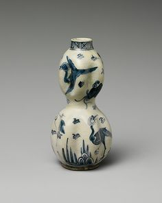 Vase in the Form of a Double Gourd    Object Name:      Vase  Date:      17th century  Geography:      Iran  Medium:      Stonepaste; painted under transparent glaze  Dimensions:      H. 5 1/2 in. (14 cm)  Classification:      Ceramics