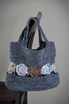 Grey Plarn Tote Bag with Inset Floral Motif. (I'm totally learning to crochet just so I can make plarn bags.)