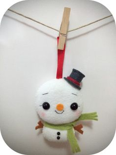 (Made to order, 2-3 business days) This cute little snowman is a perfect addition for your christmas tree. He surely will melt your heart with that