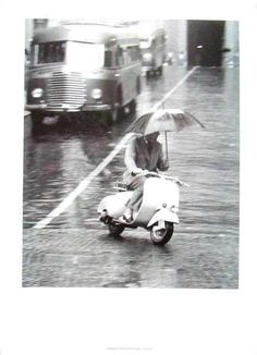 Never let a few raindrops get in the way of stylish transport: a Scooter (looks like a Vespa from here), a suit, an umbrella and a statement. Well done.