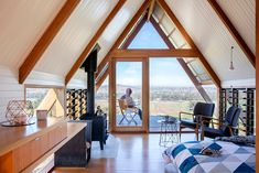 Cut-outs in the roof and windows at floor height also frame impressive views and allow natural light to fill the hut. Some panels have glass vents, which can be opened to create a cross breeze through the hut.