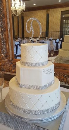 Three tier bling wedding cake with hexagon shape, quilted fondant, silver pearls and rhinestone banding  | Edible Art Bakery & Dessert Cafe, Raleigh, NC — Edible Art Bakery & Desert Cafe