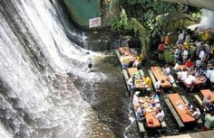 Waterfall view at the Villa Escudero Resort Waterfall Restaurant in the Philippines