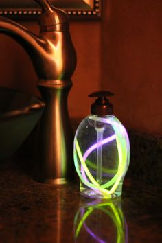 Glow sticks in soap dispenser - i might use this for a disco/70's party...or what a great way to find the bathroom in the dark