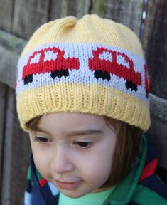 Free Knitting Pattern for Little Beep Hat -Simple beanie with a fun stranded colorwork band of bright cars driving all around the hat. Designed by Claire Slade