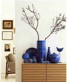 blue bitossi...oh how I wish I had this arrangement...and the very clean lines...no clutter...no cats to knock things over