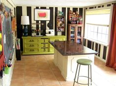 Love the chartreuse painted dresser for storage.