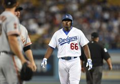 . Los Angeles Dodgers right fielder Yasiel Puig (66) has words with San…