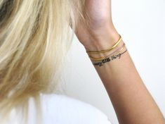 """Crazy little thing"" wrist tattoo that looks like a thin, delicate bracelet."
