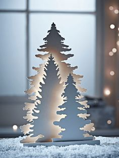 Keep your Christmas display beautifully simple with our elegant tree silhouette decoration. Consisting of three differently shaped silhouettes fixed to a single base, each tree shape is lit by warm white bulbs. Non replaceable LEDS.