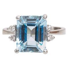 1940s Five Emerald-Cut Aquamarine and Diamond Ring
