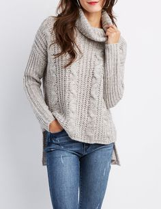 Cuddle up in this cute cowl neck sweater with a fun mixture of cable and shaker stitch knits! A chic cowl neckline tops this look while slouchy long sleeves frame the boxy silhouette. Complete the look with skinny jeans and ankle booties for an effortless look!