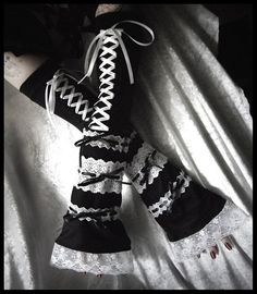 Hedonia, Queen of Shadows Elegant Black With White Lace and Black and White Ribbons Extra Long Lolita Corset Style Arm Warmers! This pair of arm warmers is a tribute to the beautiful sleeves of Gothic Lolita Dresses and Rococo fashion! They are incredibly unique, and sure to turn heads