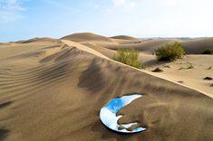 Desert mirror in sand dunes